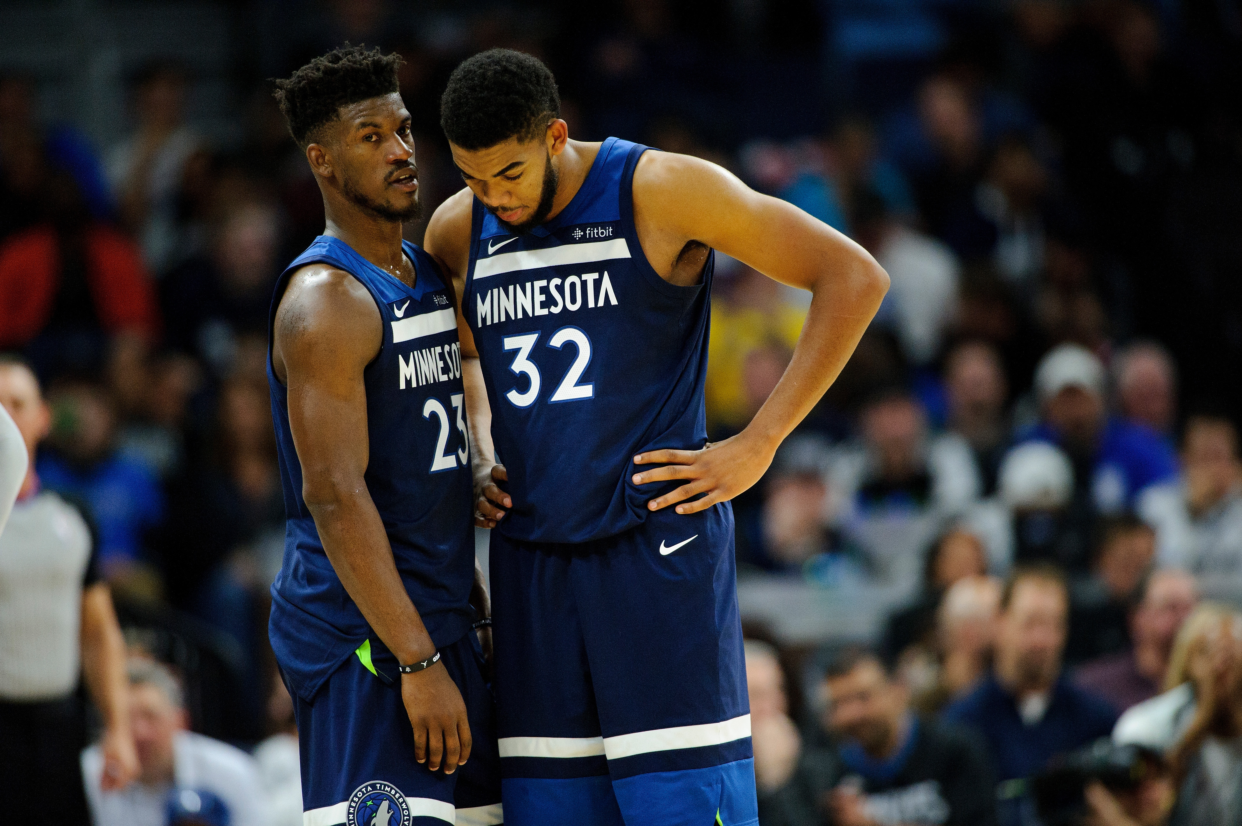 minneapolis mn october 27 jimmy butler 23 and karl anthony towns 32 of the minnesota timberwolves speak to each other during the game against the